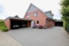 Scheeßel: Neuwertige Doppelhaushälfte mit Doppelcarport - Titelbild