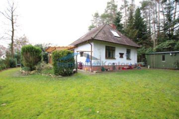 Ahausen: Wohnen im kleinen Bungalow mit Doppelcarport – auf einem großen Grundstück, 27367 Ahausen, Einfamilienhaus